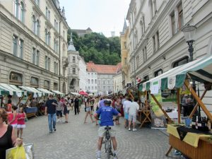 A street in the city with wine tasting stalls at the weekend